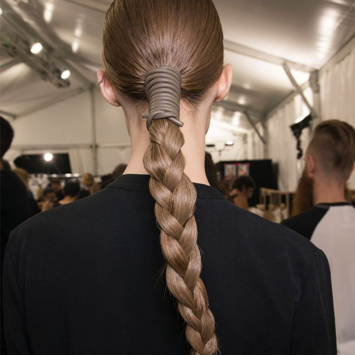 Model with her brown hair pulled back in a long braid