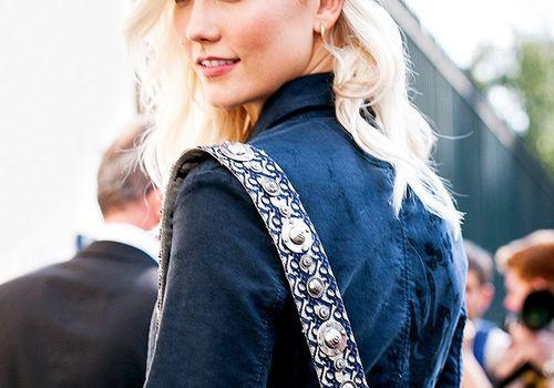 Karlie Kloss long wavy bleached blonde hair wearing a hat