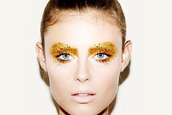 Woman with yellow glitter eyeshadow
