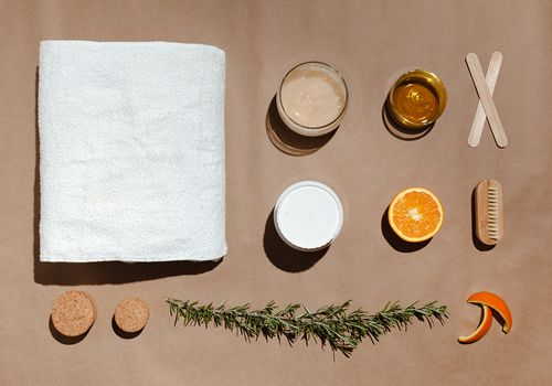 ingredients for a homemade sugar wax spread out on brown paper