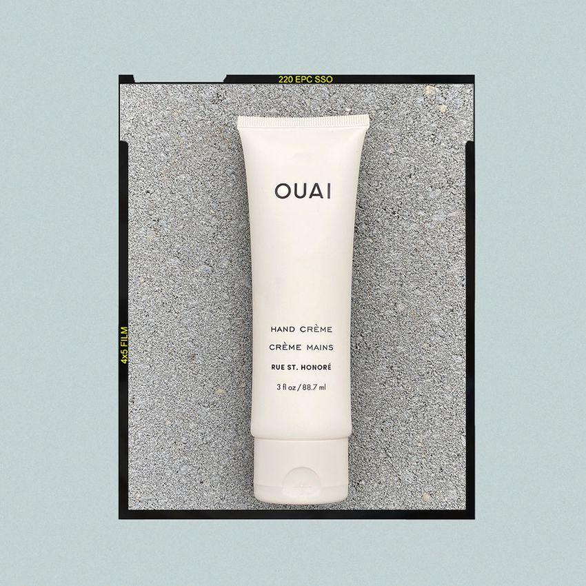 Bottle of Ouai's Hand Crème against a grey backdrop