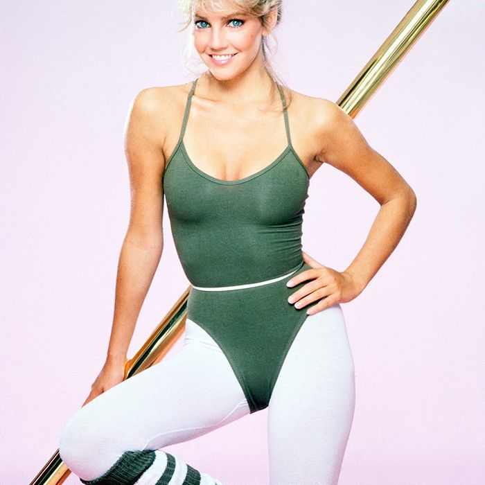 Woman smiling in 80s workout gear