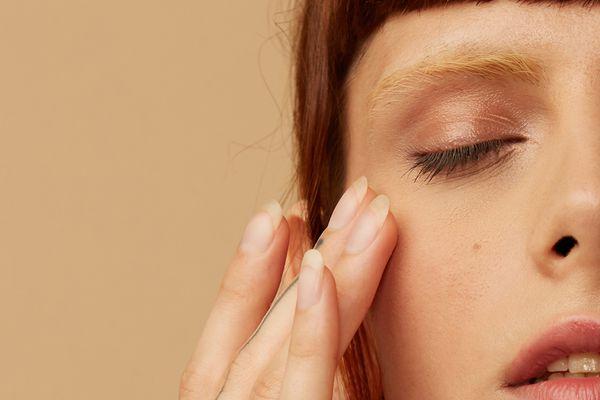 woman applying face scrub
