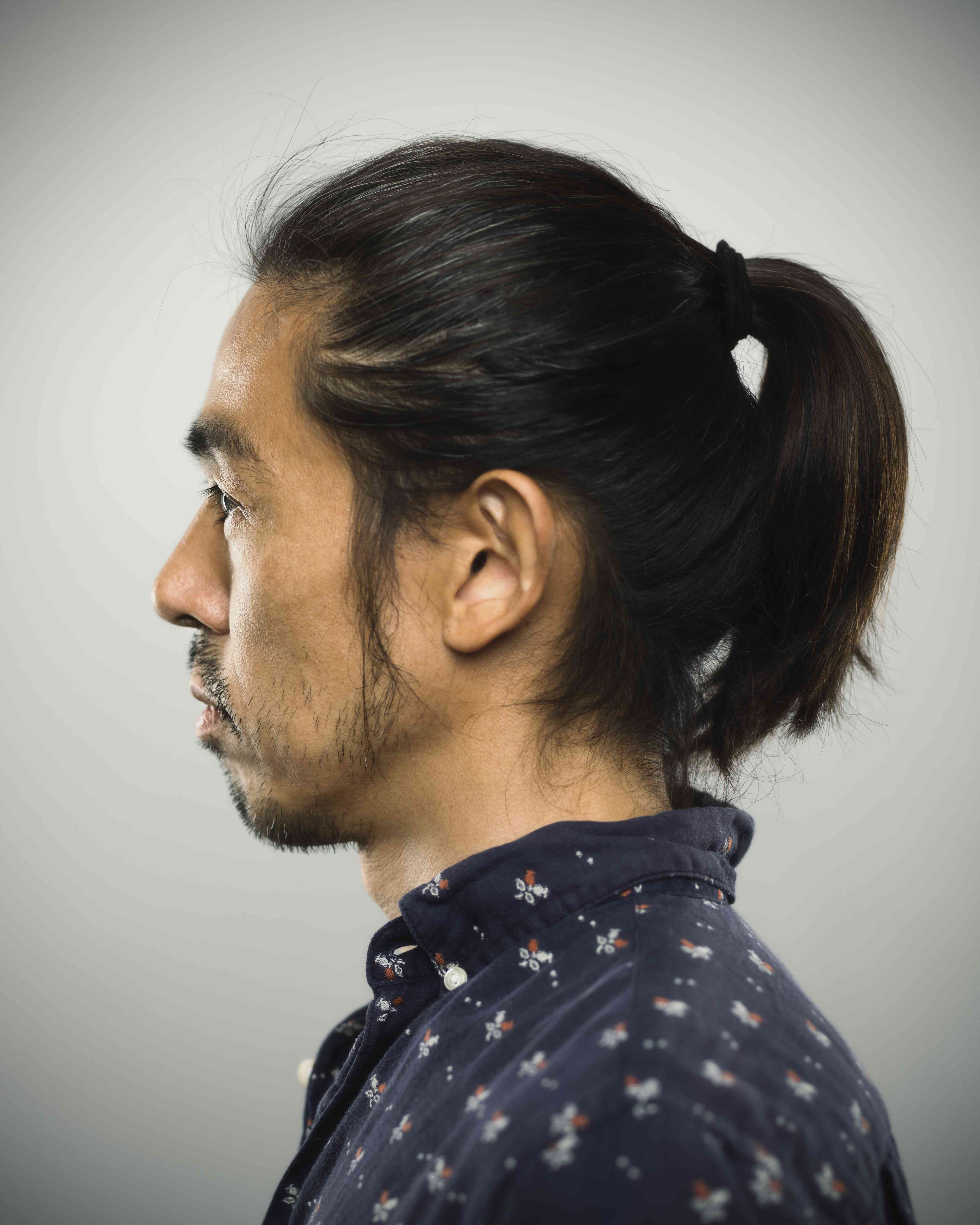 Side profile of a Japanese man with a ponytail