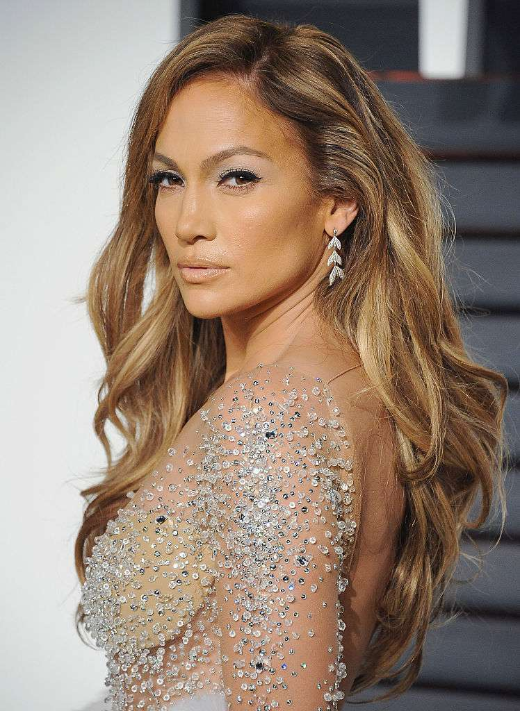 Jennifer Lopez side-parted long, glamorous waves