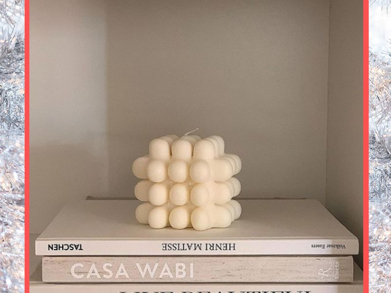 candle on stack of books
