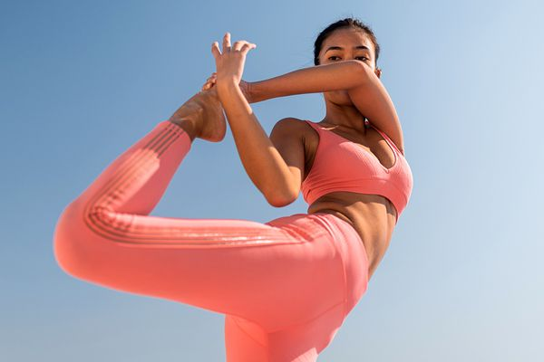person doing yoga in the sun
