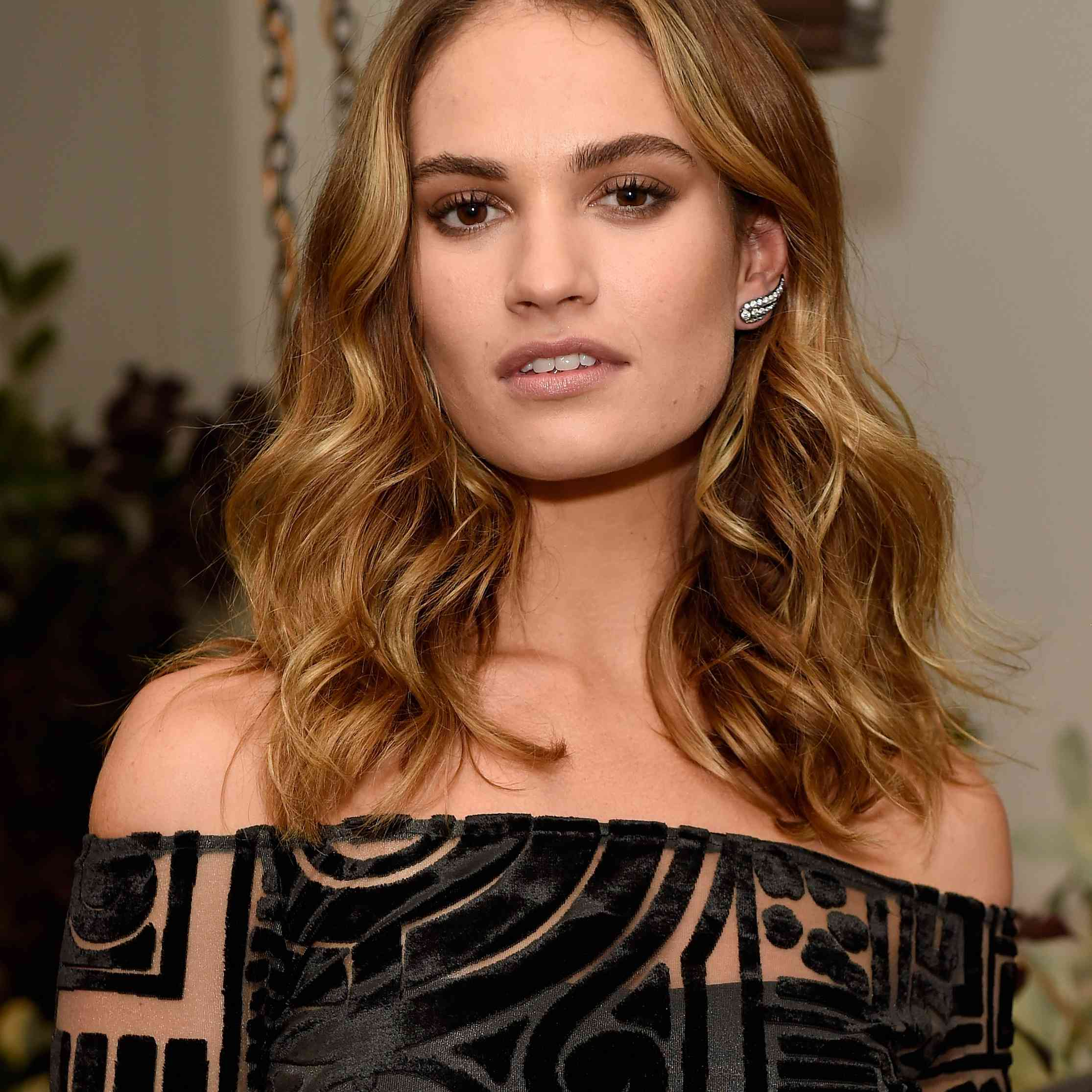 Lily James in black top