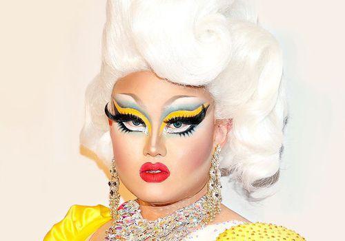 drag queen in yellow dress