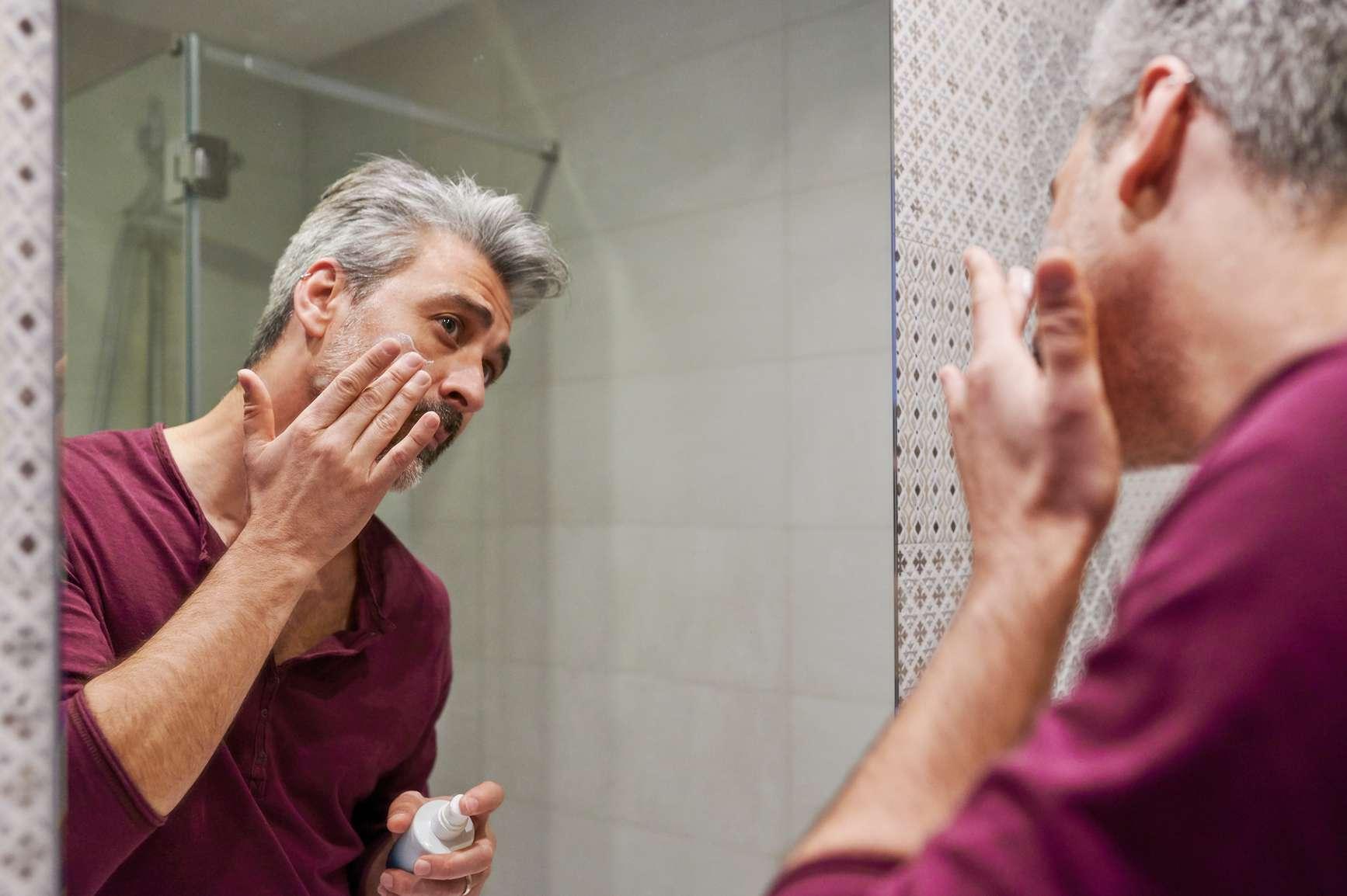 man applying beard dye