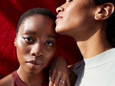 Two Black Woman on red background
