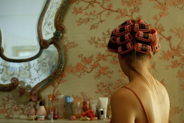 woman with rollers in hair