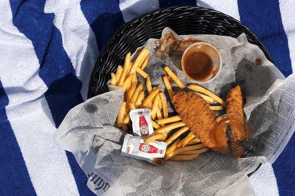 chicken tenders on blue striped towel
