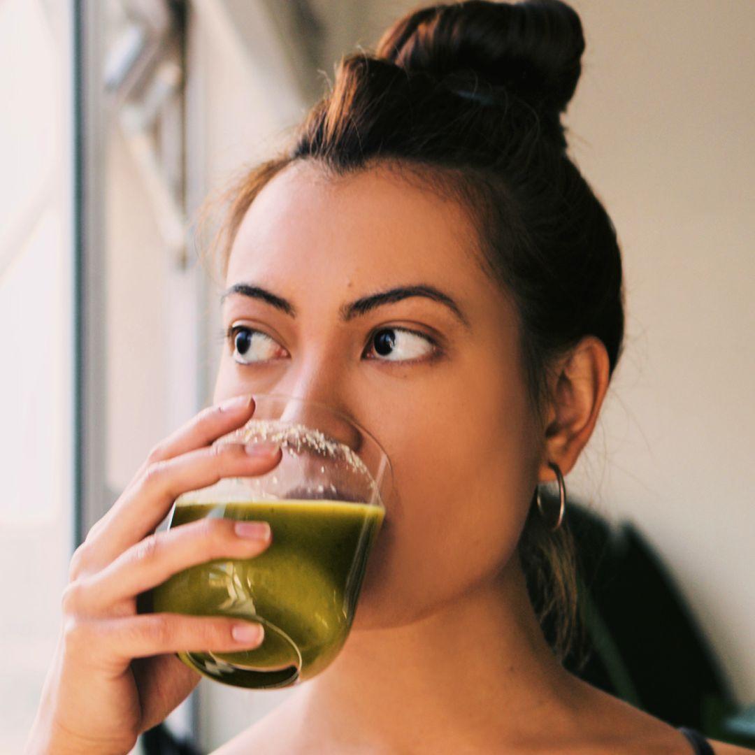 Woman drinking a detox drink
