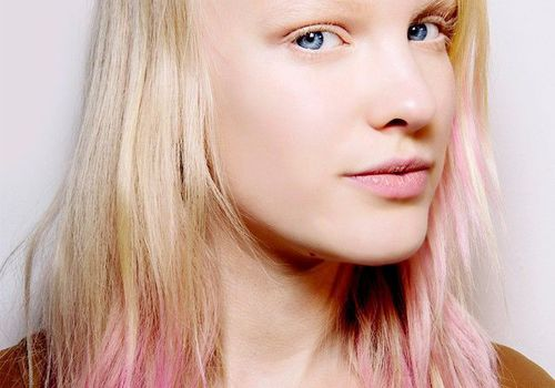 Blonde woman with blue eyes and pink dyed ends