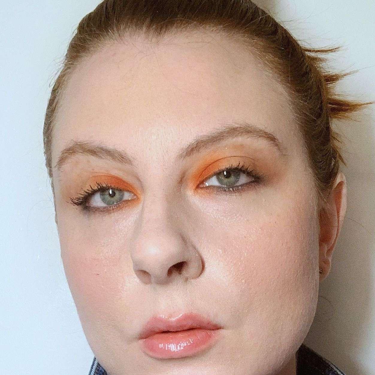 woman wearing orange eyeshadow on inner lid