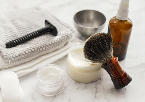 Close-up of shaving equipment on marble table