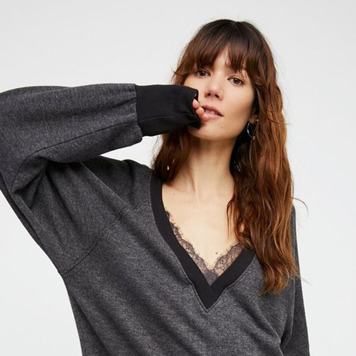 Woman wearing a gray sweater