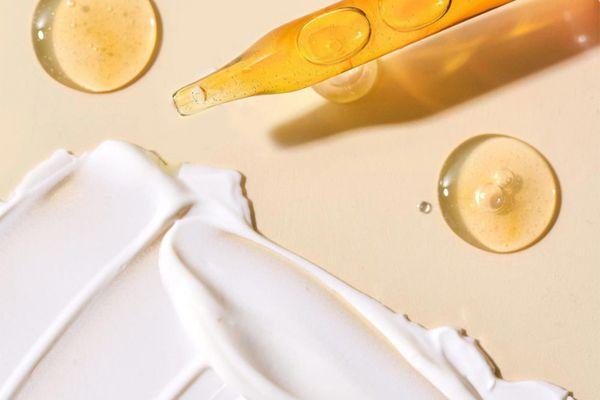 closeup oil pipette and cream moiturizer