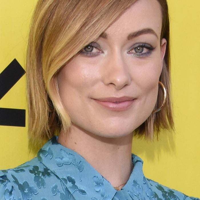 How to Find the Best Part for Your Face Shape 2014: Olivia Wilde with fringe and blue shirt