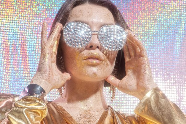 meta chromatic portrait with studded glasses and lamé