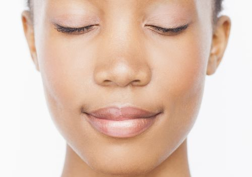 Woman with clear skin with eyes closed