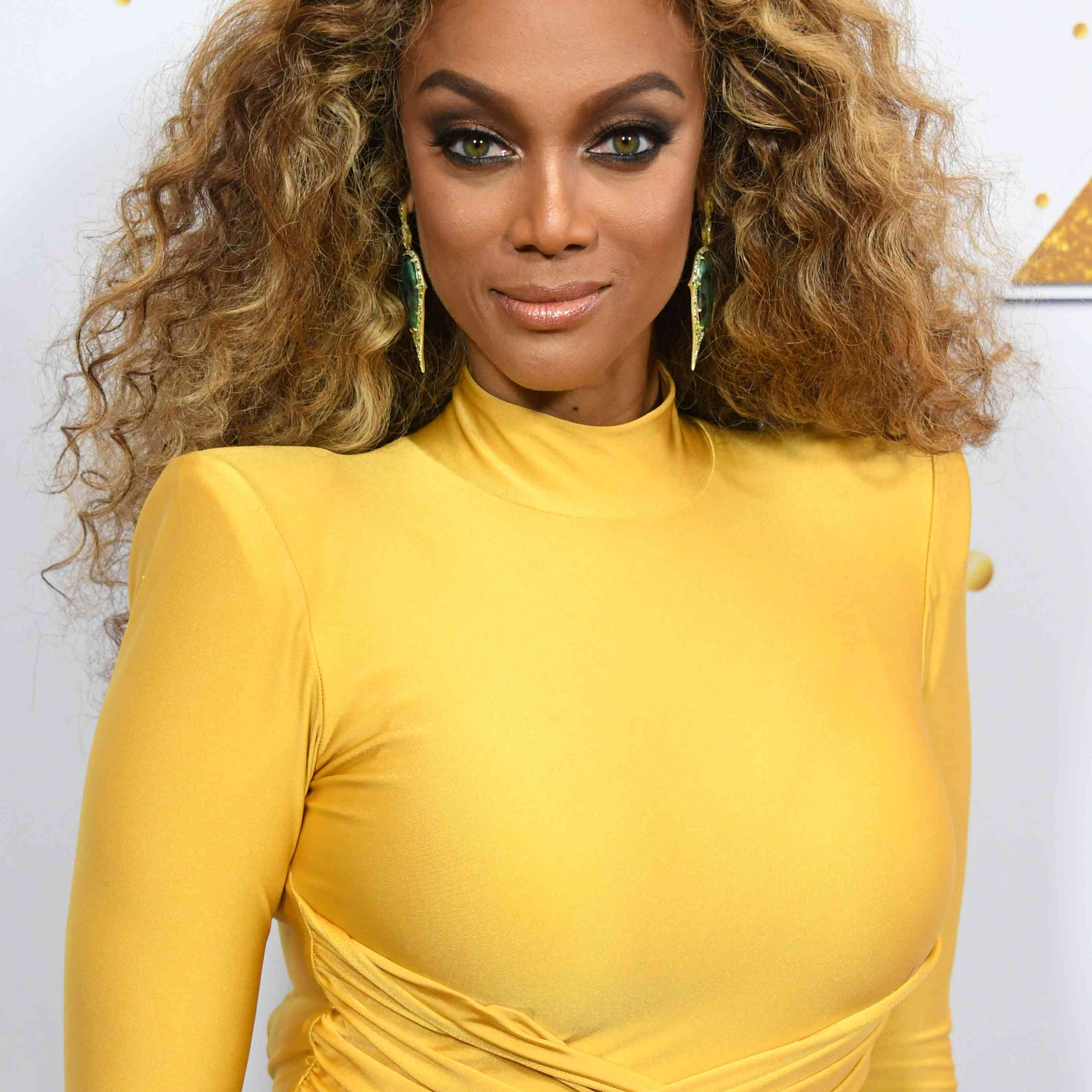 Tyra Banks in a yellow dress