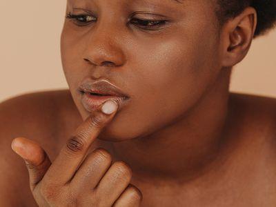 woman with lip balm