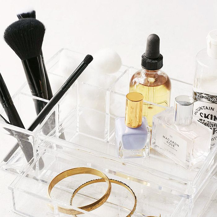Acrylic organizer with beauty products and jewelry