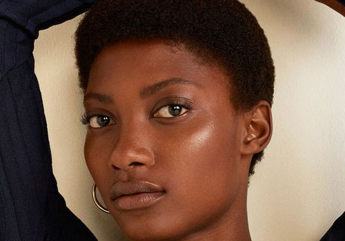woman with short hair and clear skin