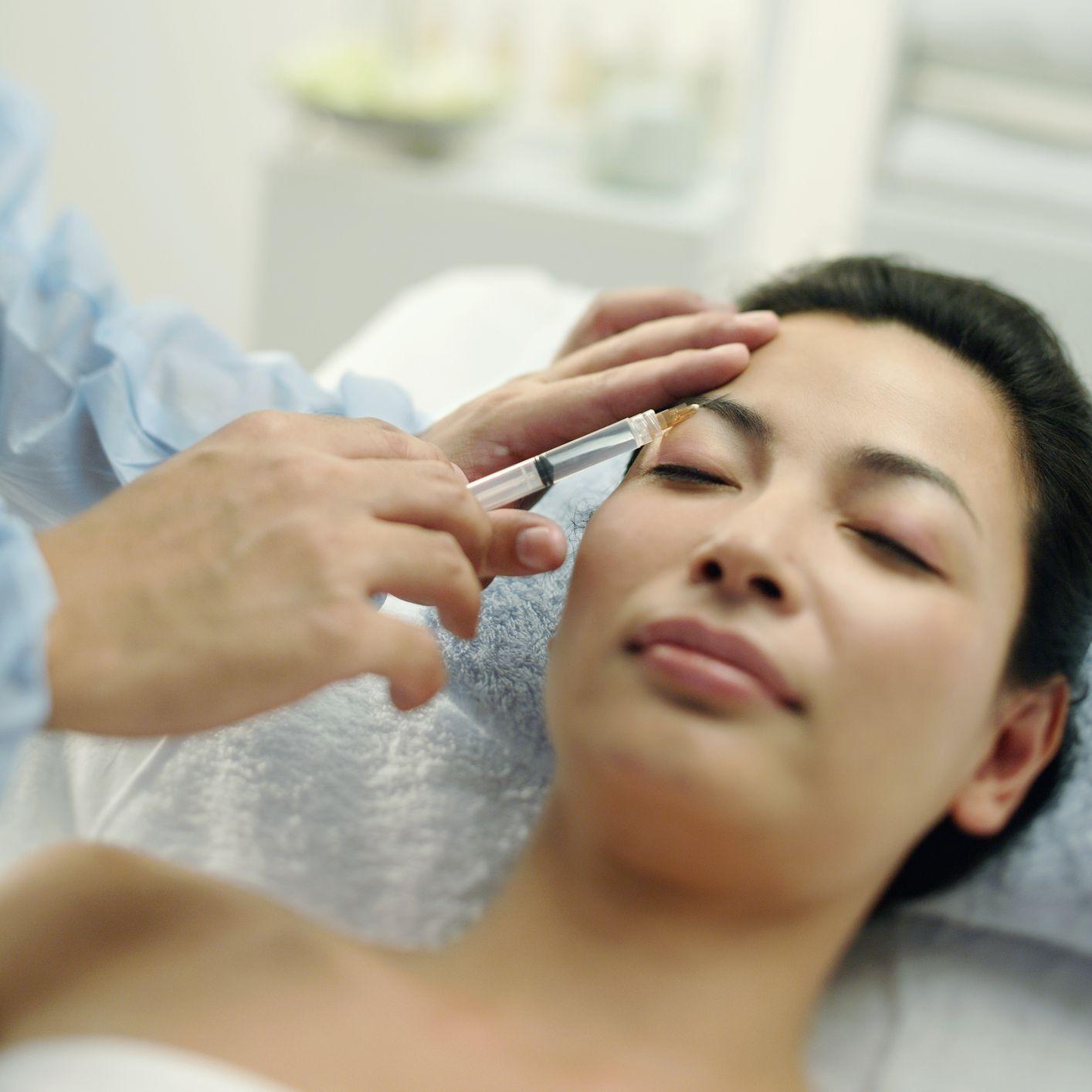 woman getting botox in brow