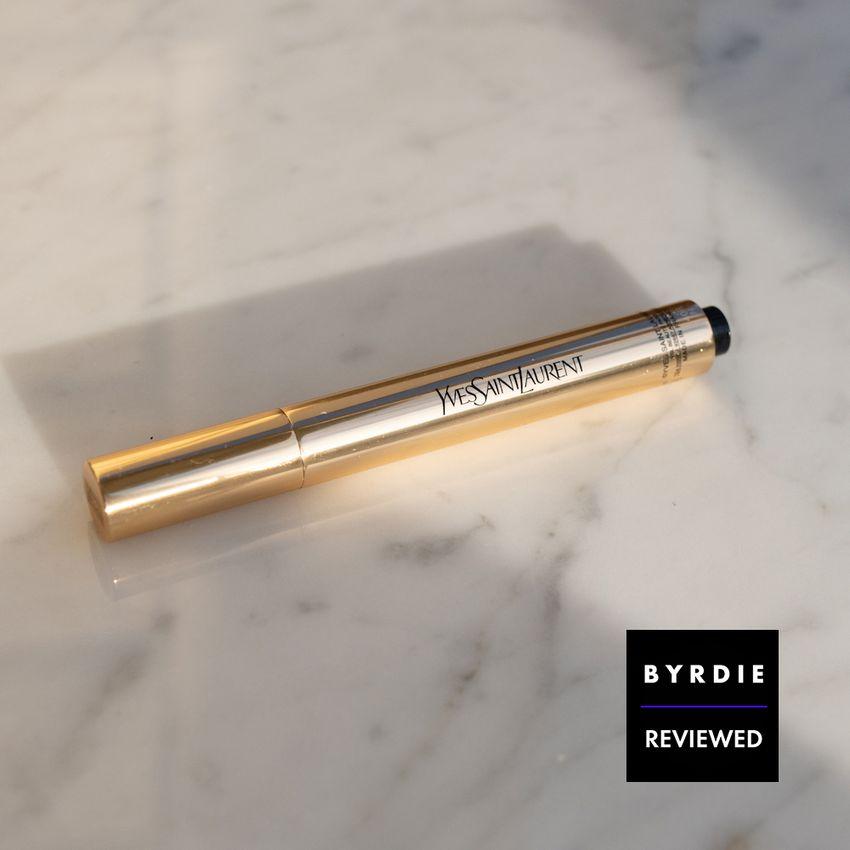 ysl touche eclat brightening pen on marble background