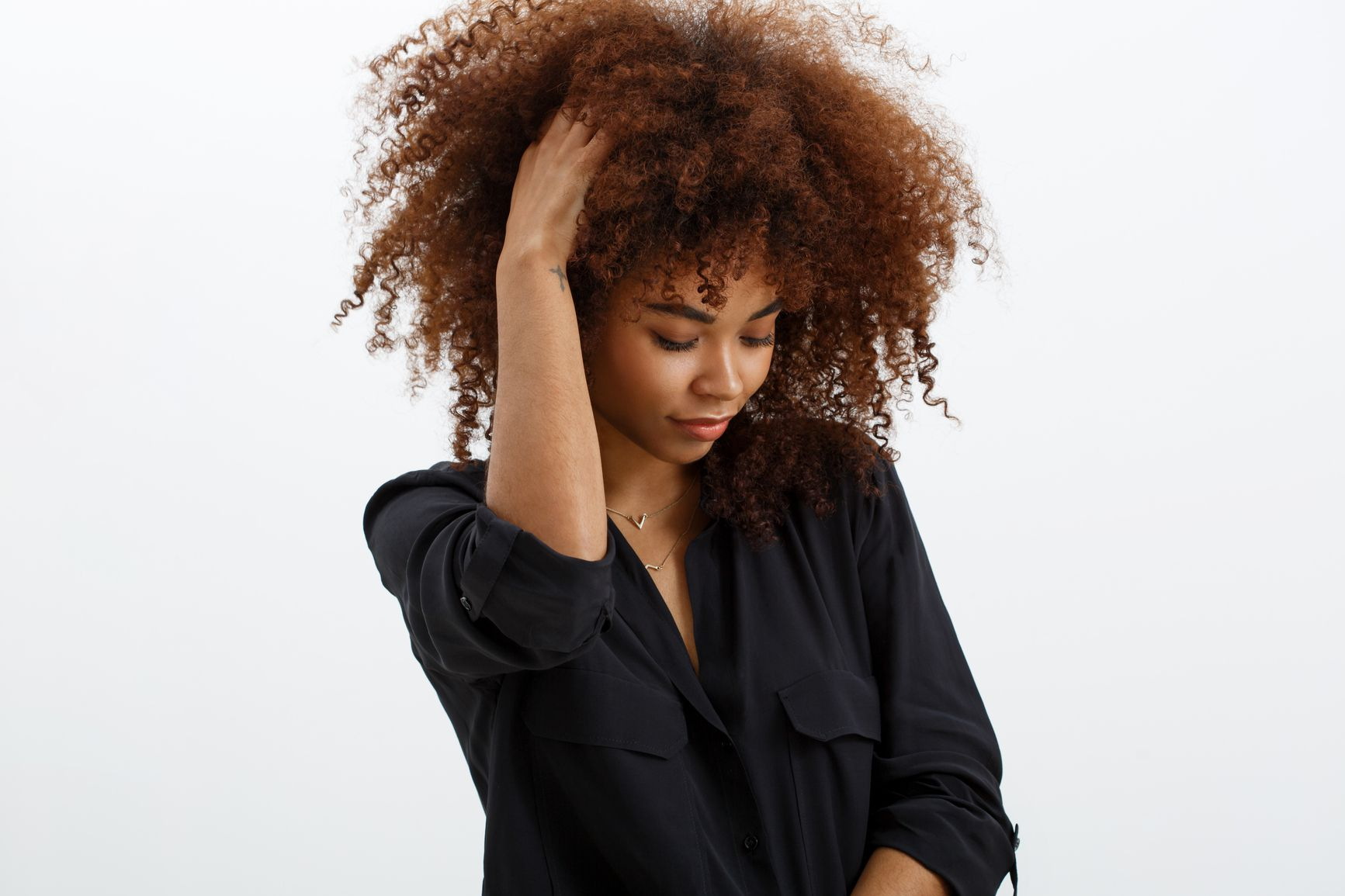 black woman touching her hair