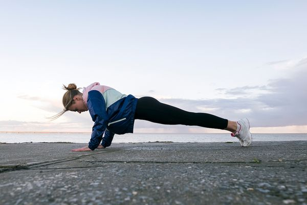 Woman performing a plank outdoors