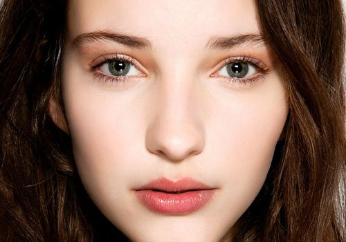 brunette girl with grey eyes and pale skin