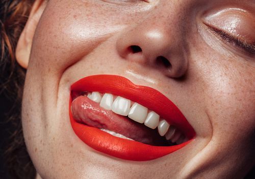 Happy woman with bright red lipstick