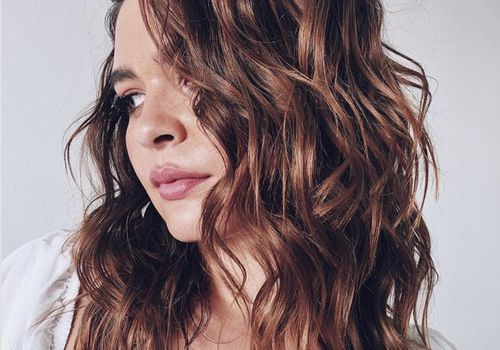 Woman looking to the side with wavy hair