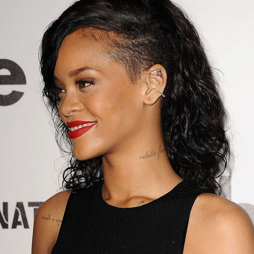 Rihanna curly, partially shaved modern mullet