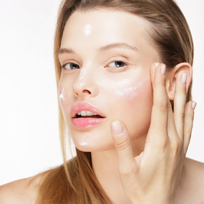 Best face creams: woman applying face cream