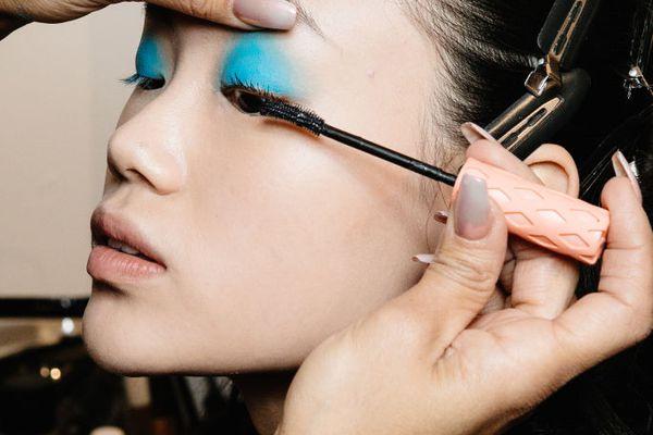 model getting mascara applied