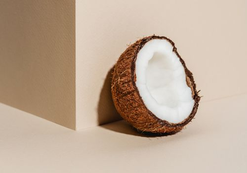 coconut against tan wall and background