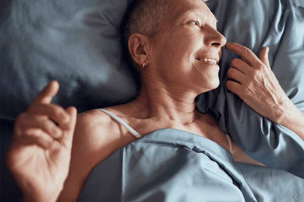 mature woman laying in bed