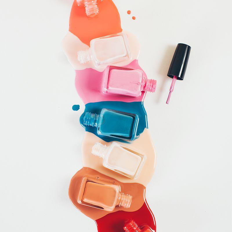 multiple bottles of spilled nail polish