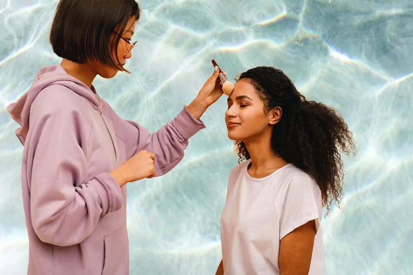 Woman doing makeup on another woman