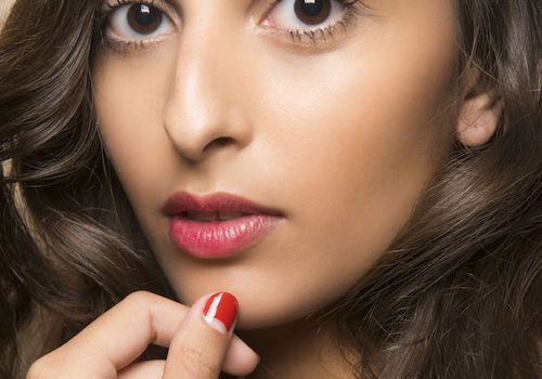 woman with red nail polish and red lipstick