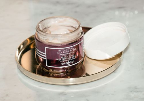 sisley paris black rose skin infusion cream on gold plate