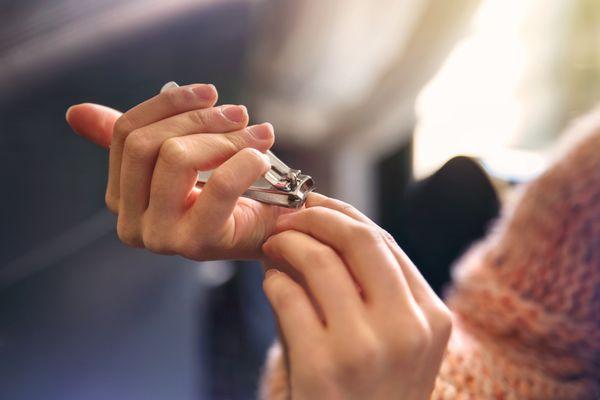 woman cutting nails