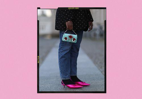 Woman wearing pink kitten heels