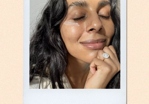 woman with a sweep of eye cream under her right eye