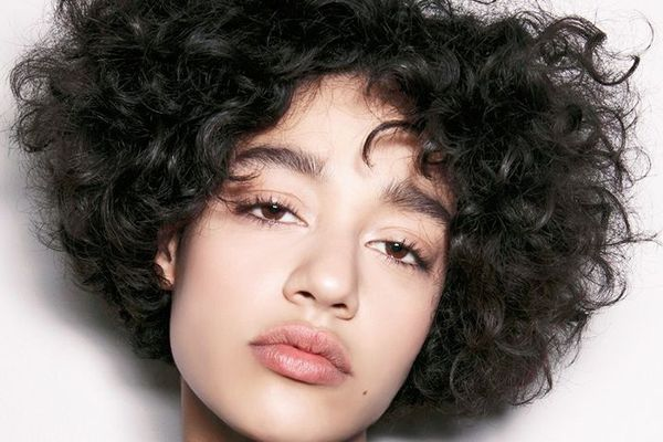 Woman with short curly hair